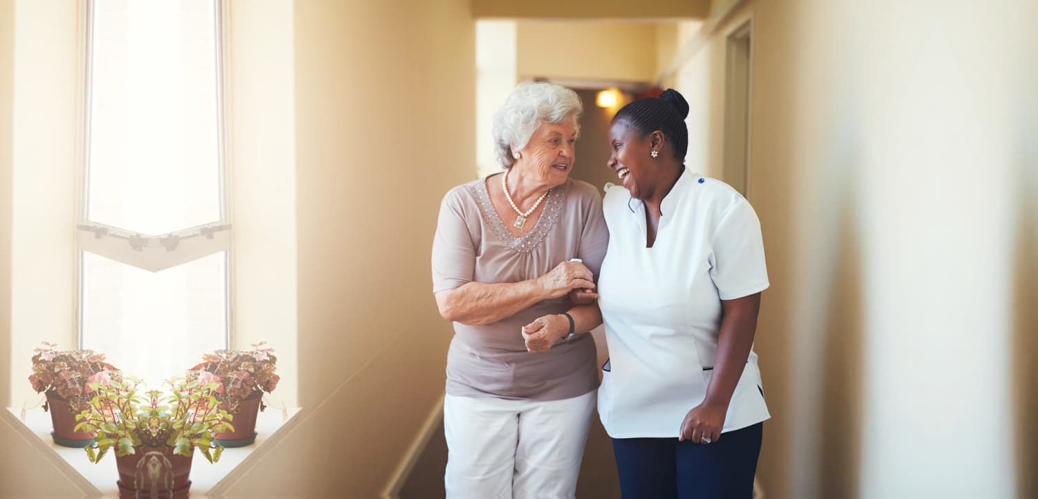 happy elderly woman and a caregiver