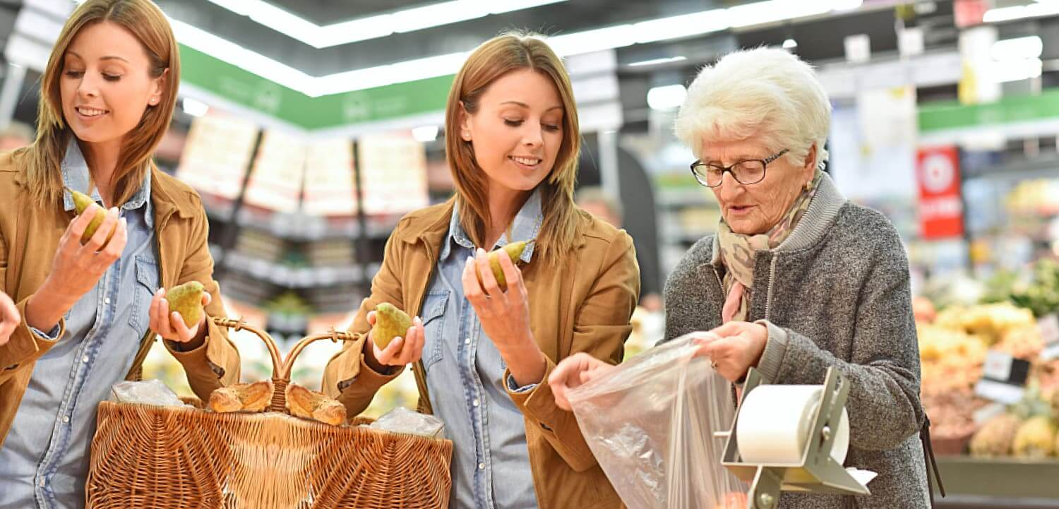 elderly woman and a woman in a grocery