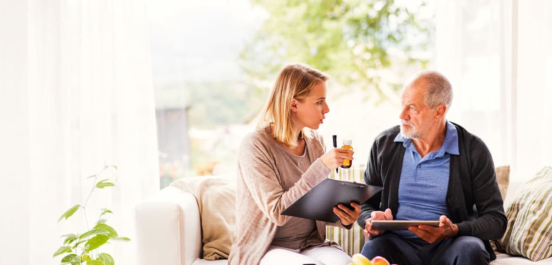 senior man and a woman talking